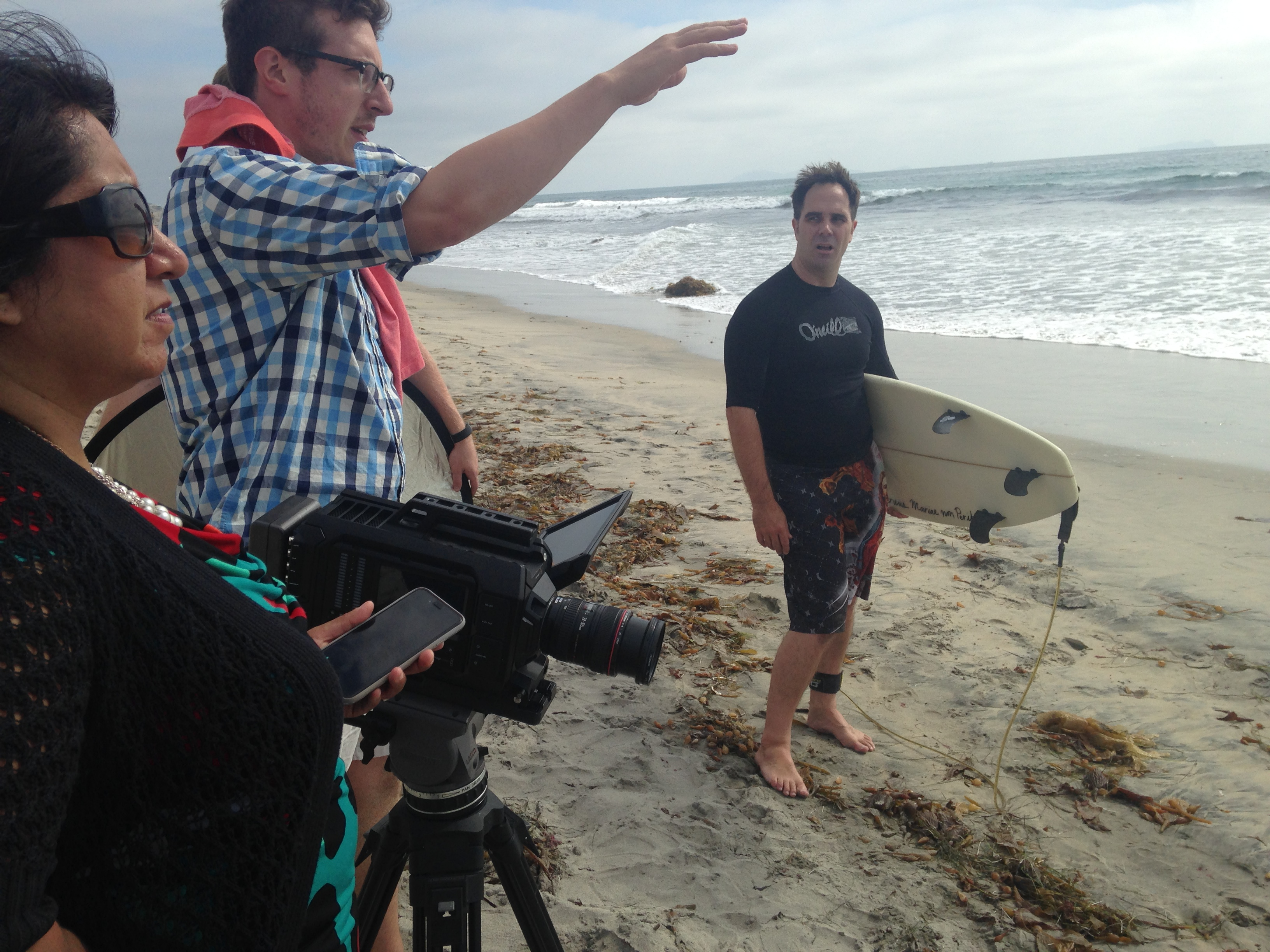 Above, Ryan is directing in California a scene from our feature length documentary Power in My Hands. He seems to be trying to calm the waves with his outstretched hand before we shoot.